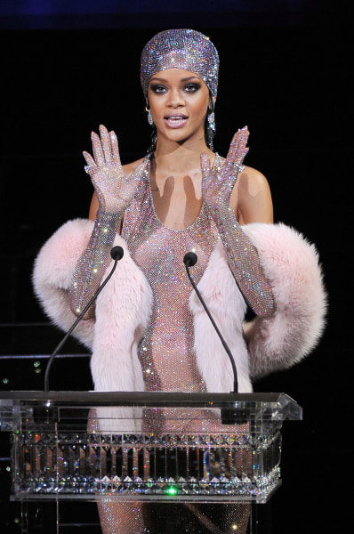 Rihanna speaks onstage at the 2014 CFDA fashion awards in New York City Monday night.