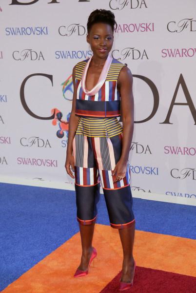 Lupita Nyong'o wears a Suno jumpsuit.