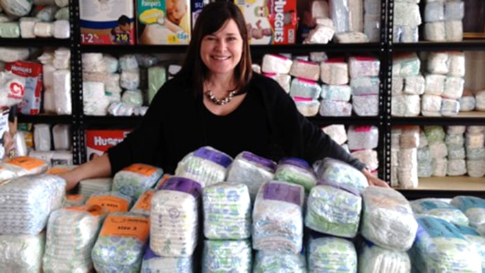 Michelle Old, executive director of the North Carolina Diaper Bank, with piles of diapers. Robbers stole one-third of the bank's supply last weekend.