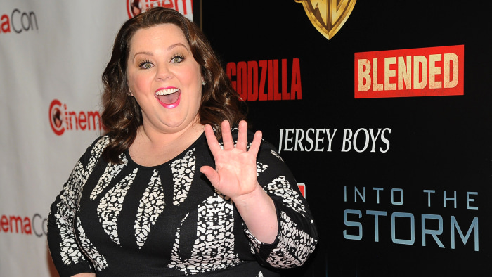 """Melissa McCarthy, a cast member, writer and producer of the upcoming film """"Tammy,"""" waves to photographers before the Warner Bros. presentation at Cine..."""