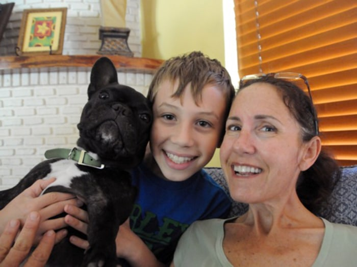 Susan Spencer-Wendel is pictured in 2013 with one of her three children, Aubrey, and her beloved dog, Lenny.
