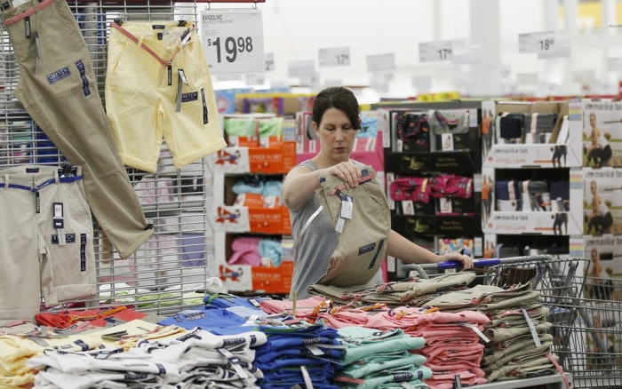 "A customer looks over the selection of clothes at a Sam's Club during a media tour in Bentonville, Ark., June 5, 2014. Sam's Club will soon offer chip-enabled ""smart"" credit cards."
