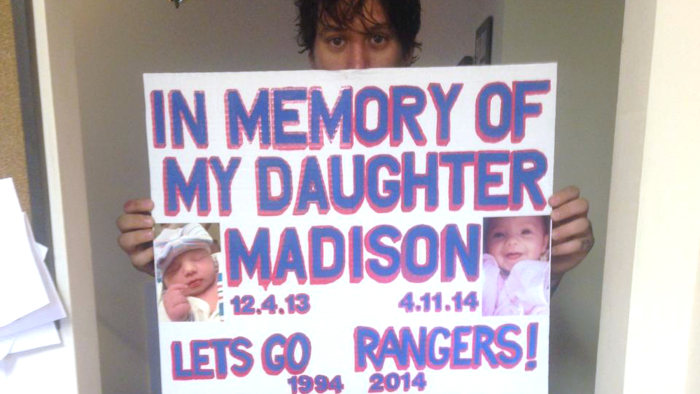 The sign that led Rangers fans to raise enough money to send a grieving dad to Stanley Cup finals.