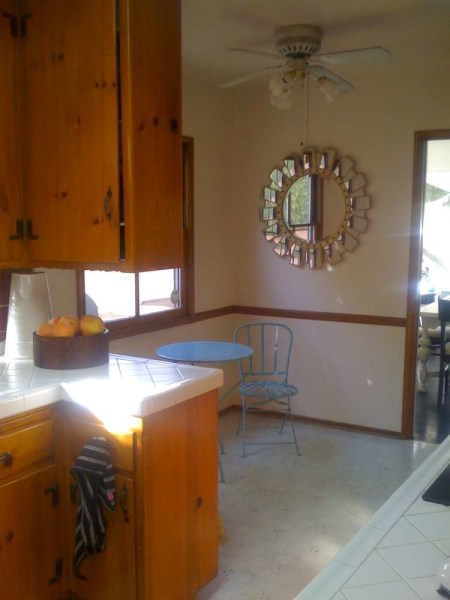 Before: The kitchen was dark and dated.
