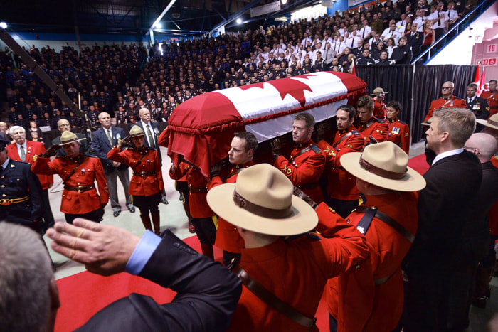 The casket of Const. Douglas James Larche, is carried in for the RCMP regimental funeral on  Tuesday, June 10, 2014 in Moncton, New Brunswick, Canada....