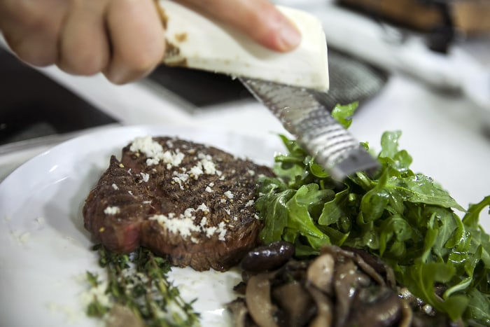 Pete Evans and Matt Lauer on the TODAY show cooking grilled sirloin with mushrooms, horseradish and arugula in New York, on June 12, 2014.