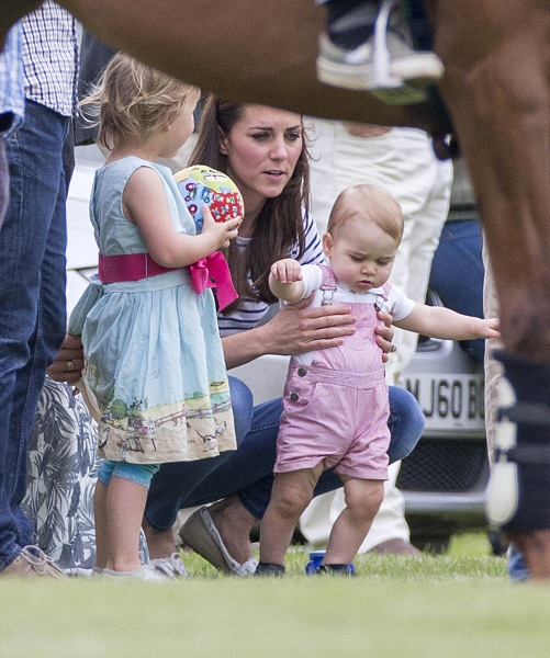 June 15, 2014 - Cirencester, Glos, United Kingdom - The Duchess of Cambridge and Prince George today watched Prince William and Harry play polo. Image...