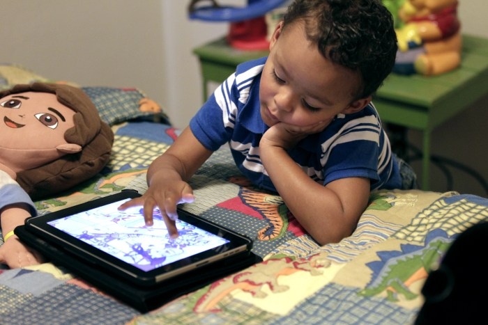 In this Friday, Oct. 21, 2011 photo, Frankie Thevenot, 3, plays with an iPad in his bedroom at his home in Metairie, La. About 40 percent of 2- to 4-y...