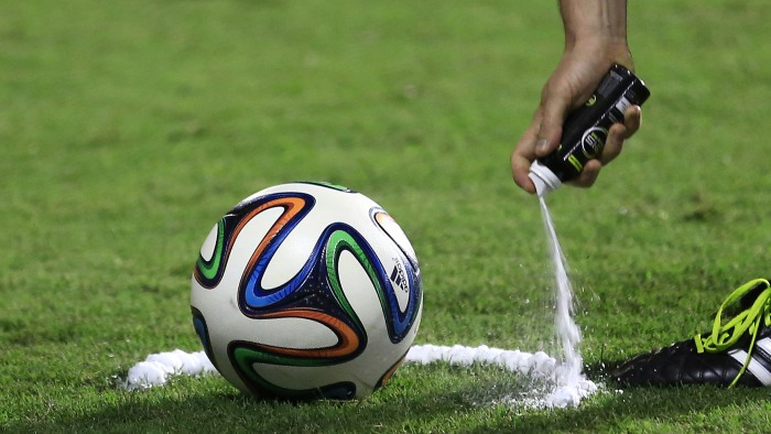 A referee uses vanishing spray during a referee's training session in Rio de Janeiro, Brazil, Friday, June 6, 2014. Referees will use vanishing spray ...