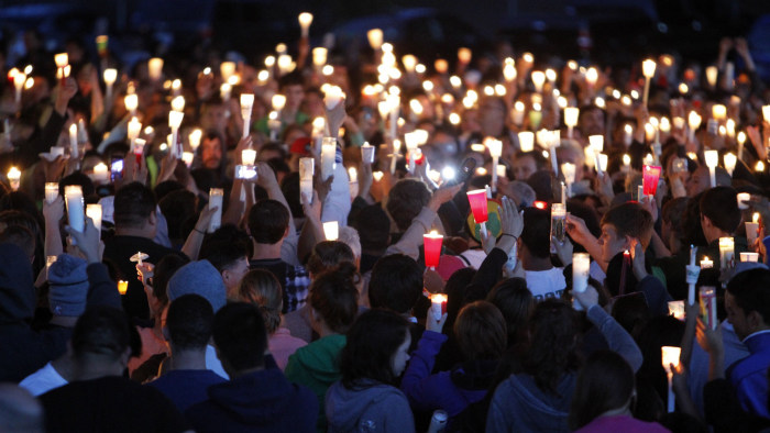Supporters attend a candlelight vigil after a shooting at Reynolds High School in Troutdale, Oregon June 10, 2014. A gunman walked into the school and...