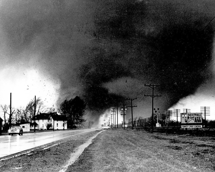 Twin tornado funnel clouds sweep along U.S. 33 near Dunlap, In. on april 11, 1965.The Palm Sunday disaster that struck the Midwest that day injured at...