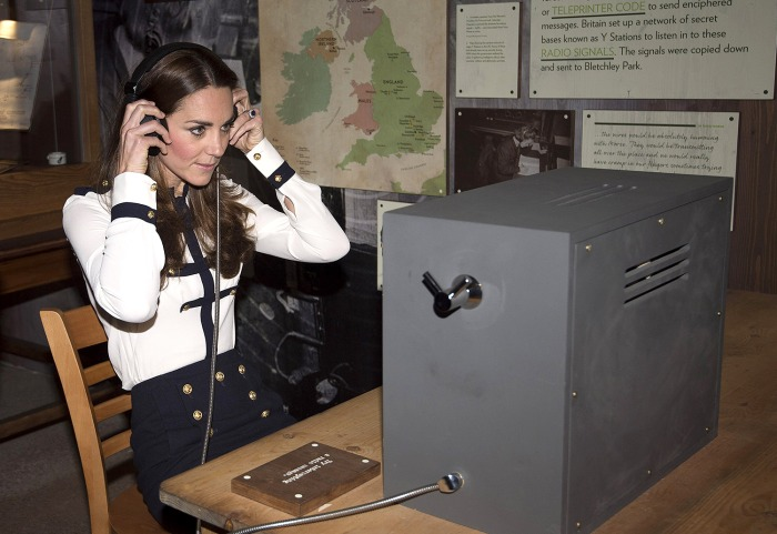 BLETCHLEY, UNITED KINGDOM - JUNE 18:  Catherine, Duchess Of Cambridge listens to a morse code message using a replica radio during a tour the of the r...