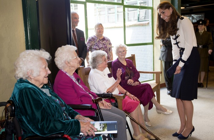 Britain's Catherine, Duchess of Cambridge (R) meets Bletchley veterans Peggy Huntington, Joan Joslin Iris King and Alma Wightman during a visit to Ble...