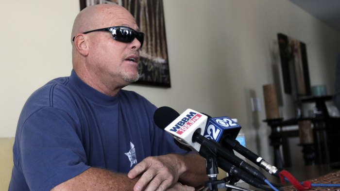 Former NFL football quarterback Jim McMahon speaks during a news conference Tuesday, June 17, 2014 in Chicago.  McMahon spoke of his ongoing battle wi...