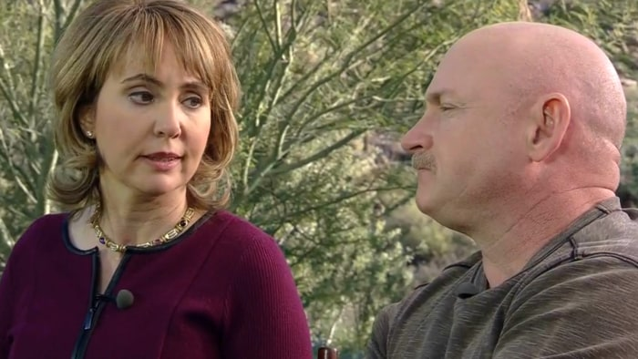 Gabrielle Giffords is pictured with her husband, former astronaut Mark Kelly, in January 2014.