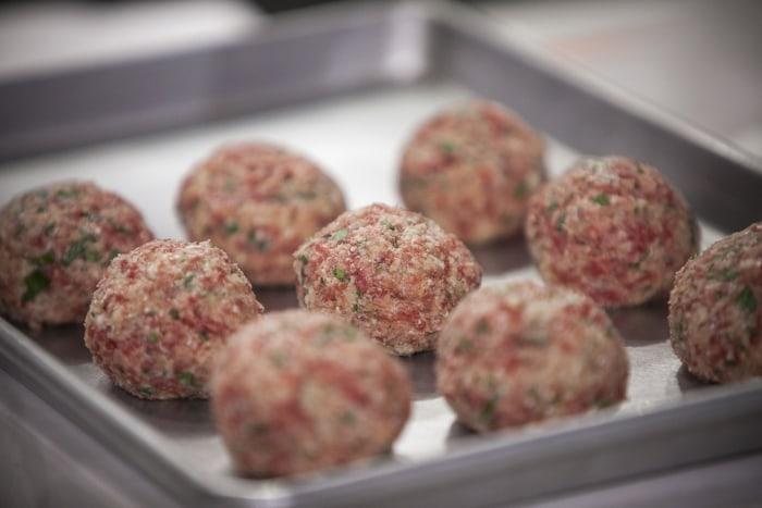 Matt Abdoo, Savannah Guthrie and Matt Lauer make Italian meatballs on the TODAY show in New York, on June 19, 2014.