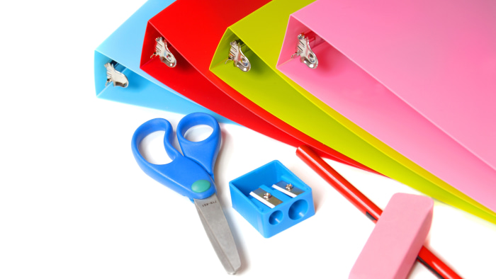 School supplies including binders, sissors, pencil, pencil sharpener and eraser