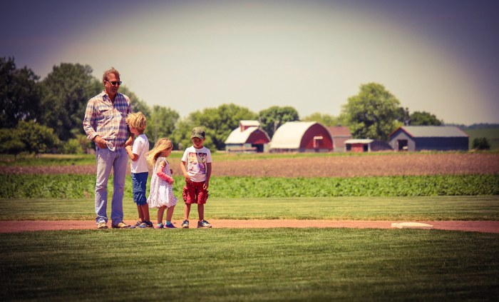 Kevin Costner and his three children walk the bases.