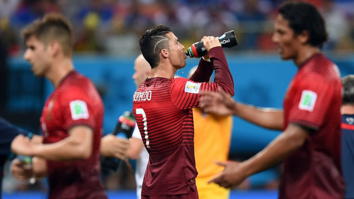 Portugal's Cristiano Ronaldo takes a historic water break along with his teammates during a 2-2 tie with the United States in the World Cup on Sunday.