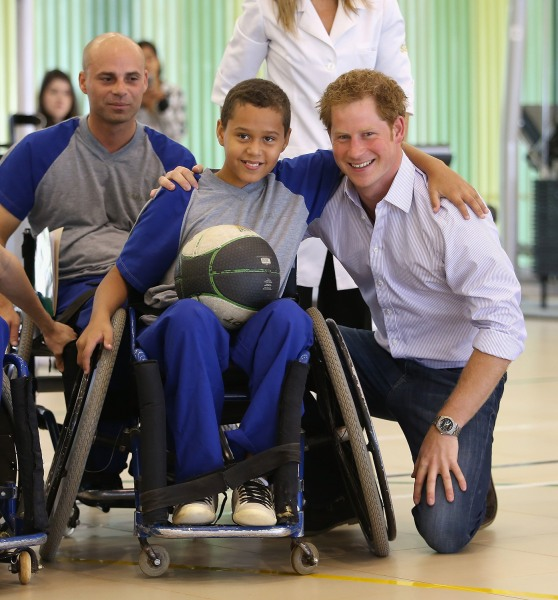 Prince Harry poses with patient Caio Carvalho, 11,at Rede Sarah Hospital on June 23, 2014 in Brasilia, Brazil.