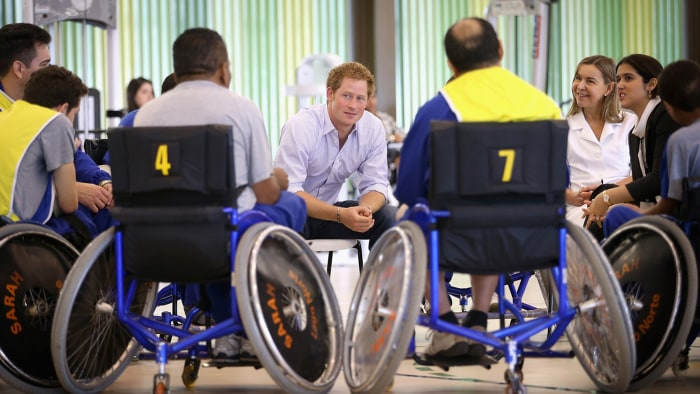 Prince Harry chats with patients at Rede Sarah Hospital as he takes part in a wheelchair basketball therapy session on June 23, 2014.