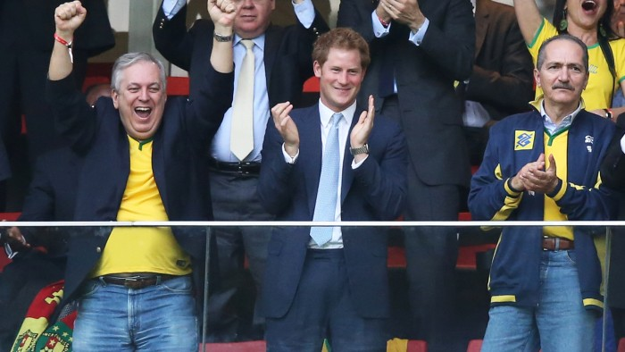Prince Harry, center, and Brazil Minister of Sport Aldo Rebelo, right, celebrate the first goal of Neymar da Silva Santos Júnior of Brazil during the 2014 FIFA World Cup Brazil Group A match between Cameroon and Brazil on June 23 in Brasilia.