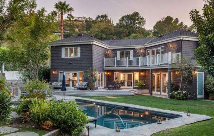 French doors open to a secluded park-like backyard, according to the listing for Neil Patrick Harris' home.