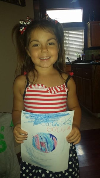 "This artistic little fan made her own ""Go USA"" sign."