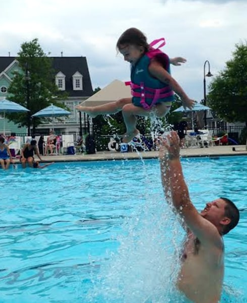 Jay Hunyor giving his daughter Natalie some airtime at the pool.