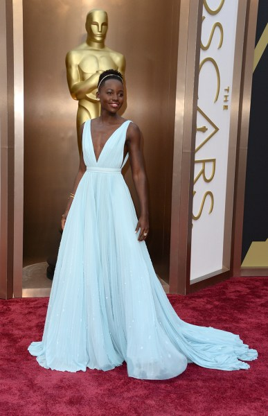 """Nominee for Best Supporting Actress in """"12 Years a Slave""""  Lupita Nyong'o arrives on the red carpet for the 86th Academy Awards on March 2nd, 2014 in ..."""