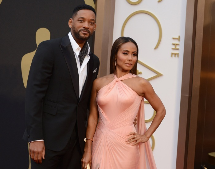 Will Smith, left, and Jada Pinkett Smith arrive at the Oscars on Sunday, March 2, 2014, at the Dolby Theatre in Los Angeles.  (Photo by Jordan Strauss...