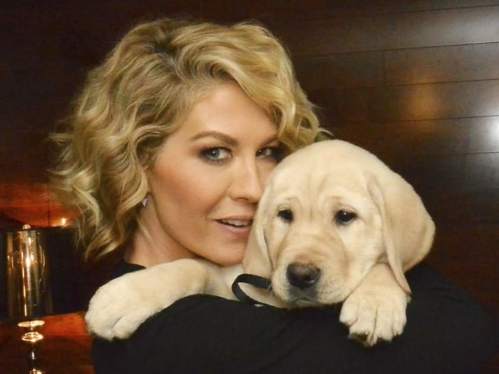 Jenna Elfman cuddles with 8-week-old Guf.