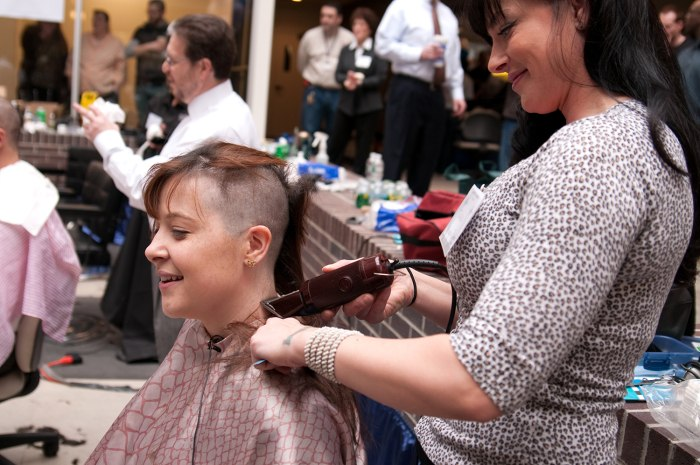 Image: Haircuts for charity at Granite Telecommunications