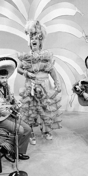 Willard Scott dresses up as Carmen Miranda for a broadcast.