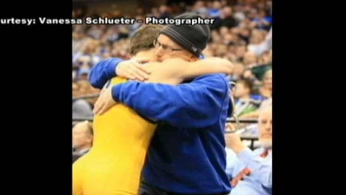 Michael Albertville High School sophomore Mitchell McKee shared an emotional hug with his father, who is battling terminal cancer, after winning the Minnesota state wrestling title at 120 pounds.