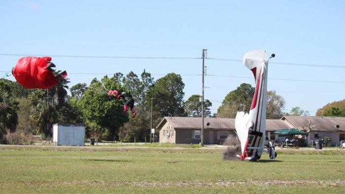 The plane nose-dives into the ground. Both the pilot and the skydiver survived.