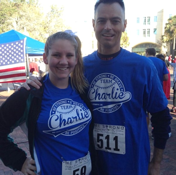 Teacher Charles Lundell, known as Charlie, with student Savannah Bendik at a cancer 5k race last year. Students wore team Charlie shirts and supported...