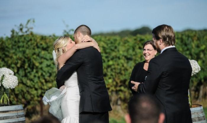 Ryan kisses his wife.