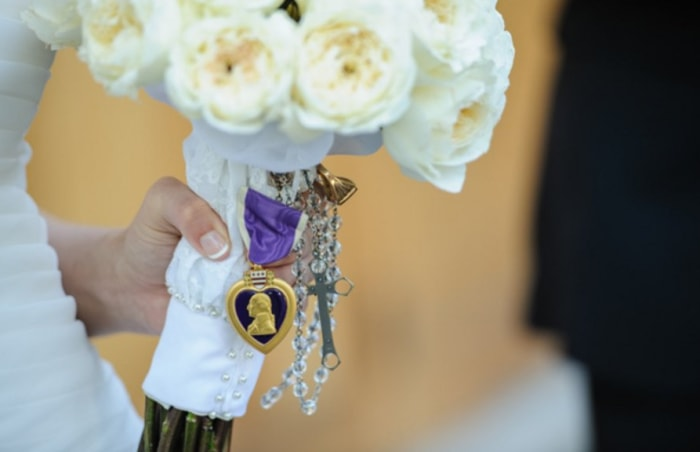 Sara's wedding bouquet was adorned with family keepsakes.