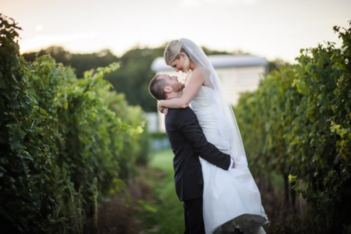 Sara and Ryan share a moment in the vineyard before the reception.