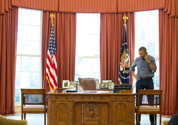 President Barack Obama talks on the phone in the Oval Office with Russian President Vladimir Putin about the situation in Ukraine, March 1, 2014. (Off...