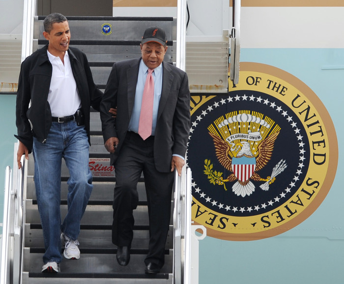 President Barack Obama, left, escorts Hall of Famer Willie Mays, right, on his arrival at Lambert St. Louis International airport Tuesday, July 14, 20...