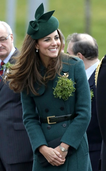 Britain's Catherine, Duchess of Cambridge wears a sprig of shamrock during  a visit with her husband Prince William to the 1st Battalion Irish Guards ...