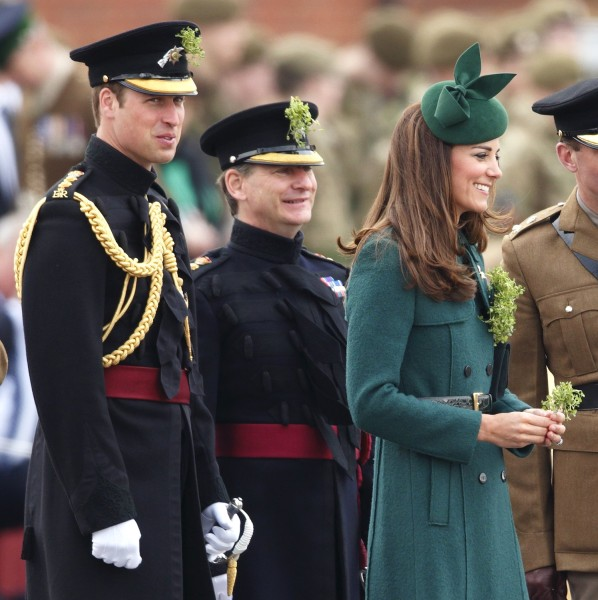 Prince William looks on as the Duchess of Cambridge presents shamrocks to the Irish Guards during the St Patrick's Day Parade on March 17.
