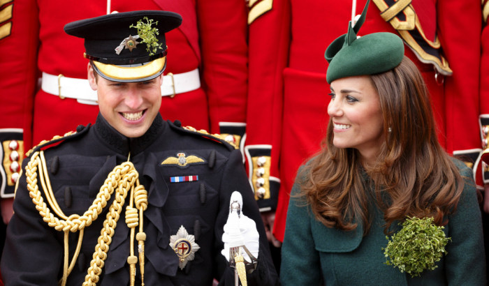 The Duke and Duchess of Cambridge share a laugh as they pose for a group photograph with soldiers of the Irish Guards.