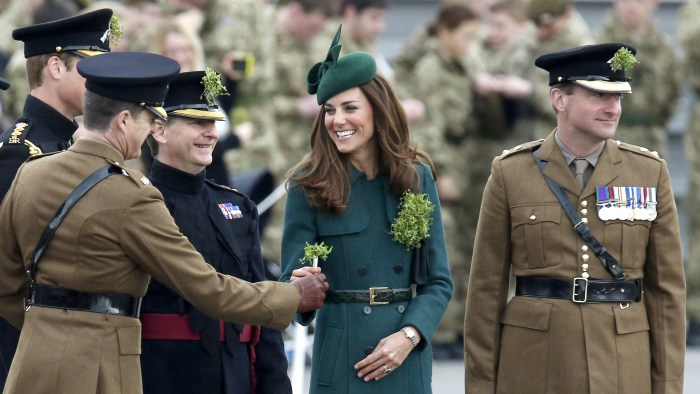 Britain's Catherine, Duchess of Cambridge presents shamrocks to officers and guardsmen of the 1st Battalion Irish Guards during a visit with her husba...