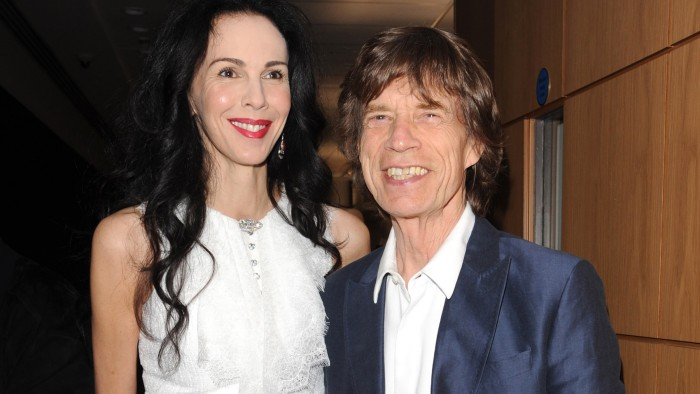 LONDON, UNITED KINGDOM - JULY 11: L'Wren Scott and Mick Jagger attend the private view of 'The Suzy Menkes Collection: In My Fashion' at Christie's on...