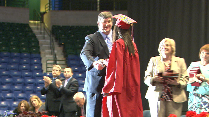 "Sydney, receiving her high school diploma, is in college and trying to find a ""new normal."""