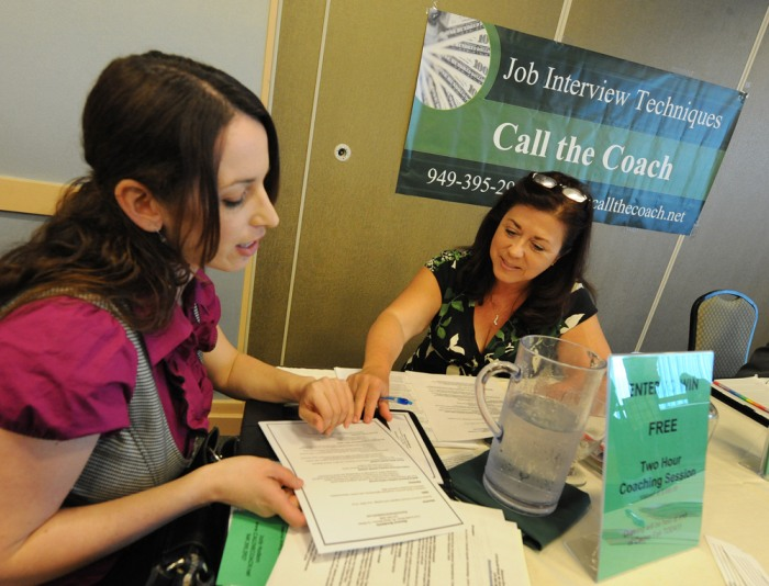 An unemployed woman receives interview technique coaching at the Los Angeles Career Fair in this March 2010 file photo.