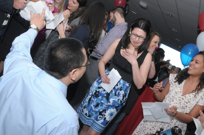 Roger Luo, a Stony Brook University School of Medicine fourth-year student, proposes to classmate and girlfriend Gaby Chancay at the school's Match Day ceremony on Friday.
